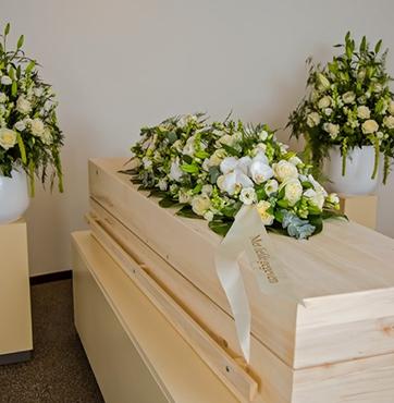 Kistbedekkingen en rouwbloemen